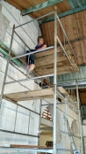 Mel on scaffold painting